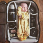 Baby in photo bag